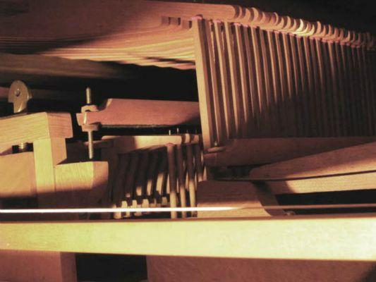Inside-the-cabinet-levers-connect-keyboard-to-valves-of-pipes