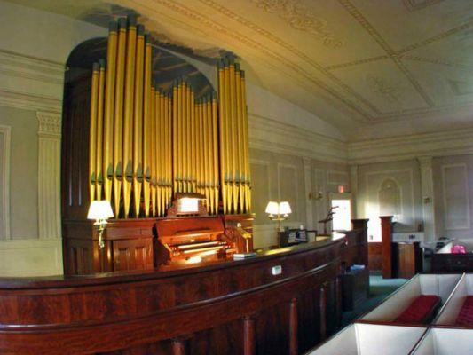 The organ is on a raised platform also used as a choir loft
